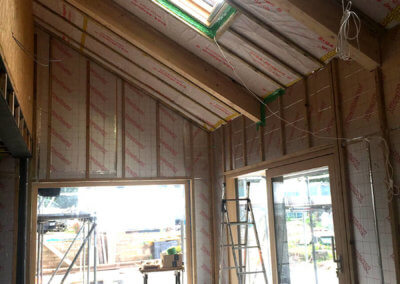 SIPs panel construction with air tightness membrane and internal insulation